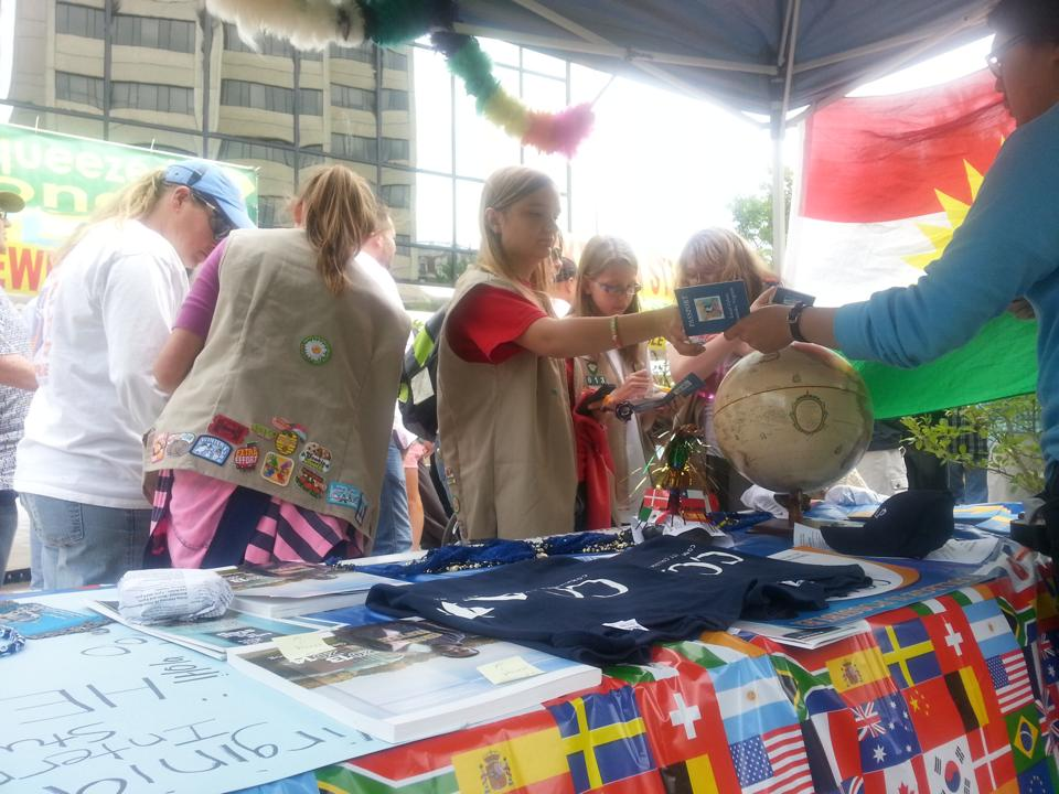 Girl scouts visiting the CCAP and International Student Club table at Local Colors.