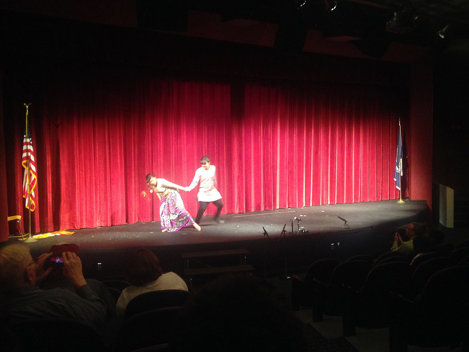 Students performing on stage in Whitman Auditorium.
