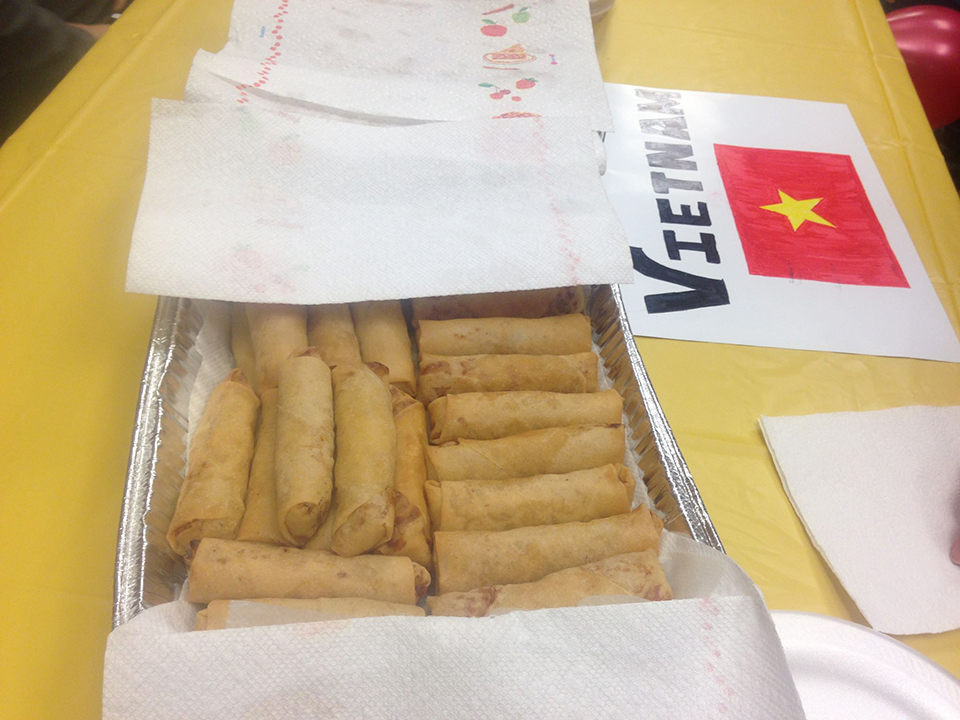 Eggrolls were provided at a table representing Vietnam at the international student celebration.