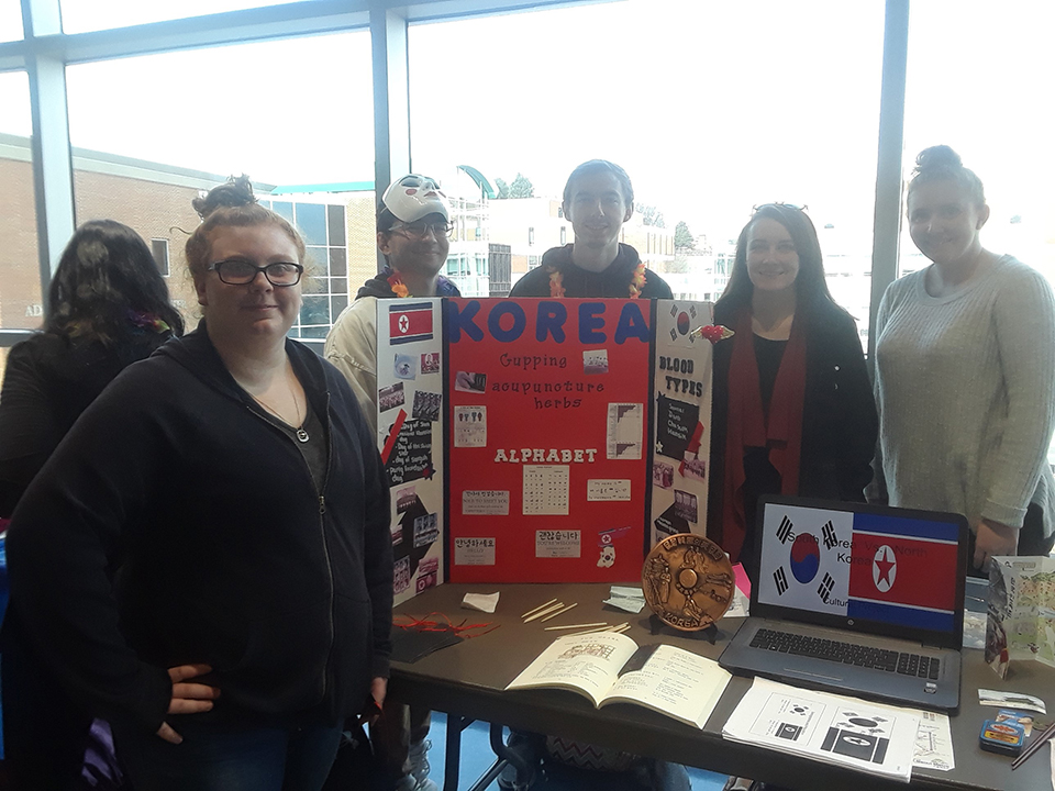 An additional view of the Korea table at the Nursing Cultural Fair and the students who worked on this project.