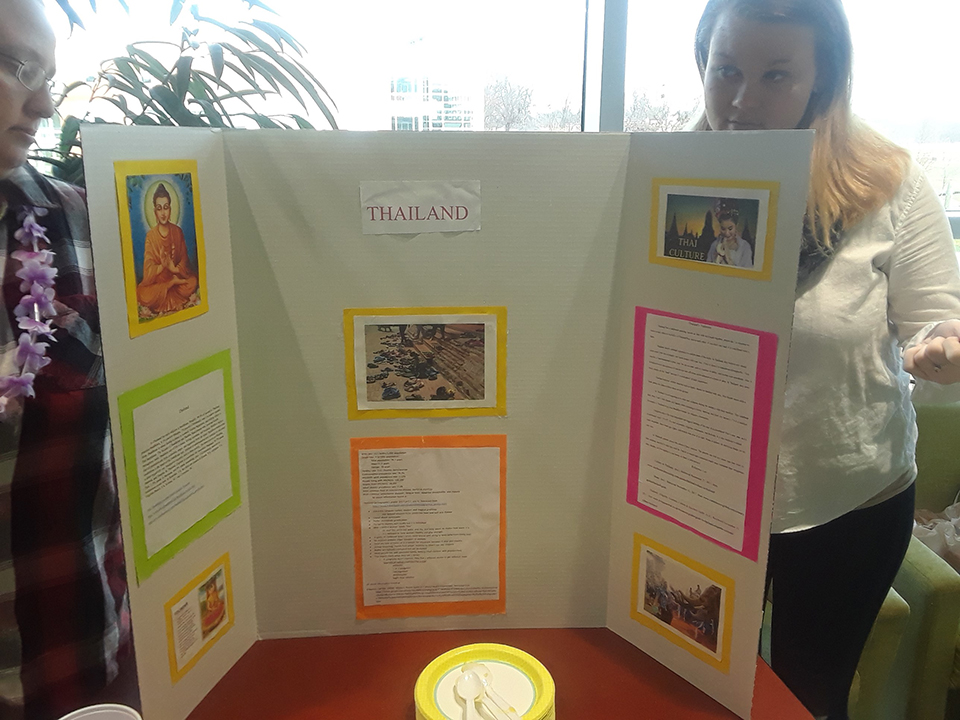 The culture of Thailand is represented at a table at the Nursing Cultural Fair. Students are seen here with information about the culture.