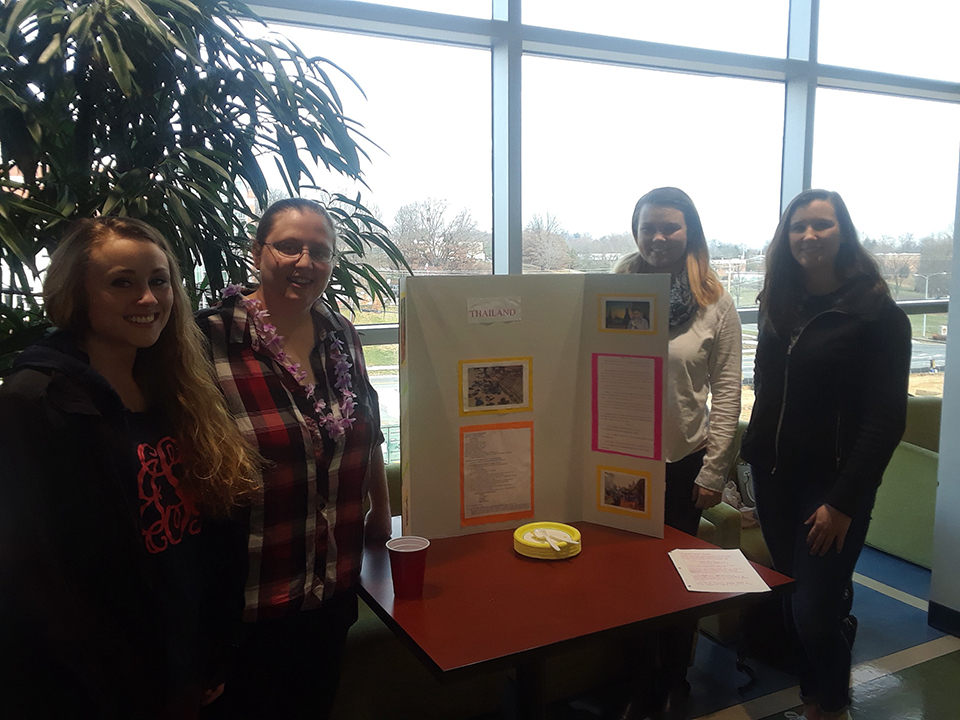 Students are pictured at their table at the Nursing Cultural Fair.