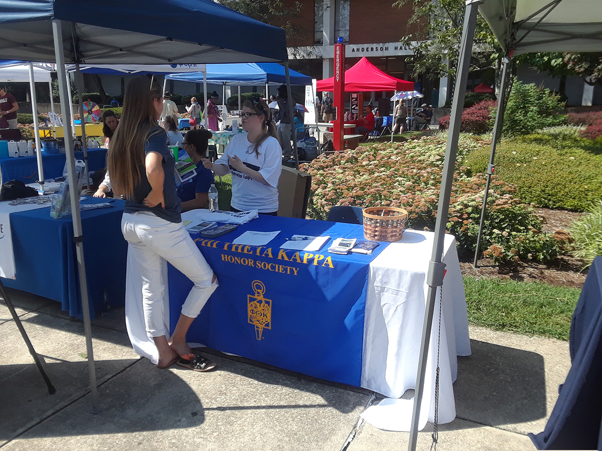 A student is learning about Phi Theta Kappa (PTK) honor society at Virginia Western Community College.