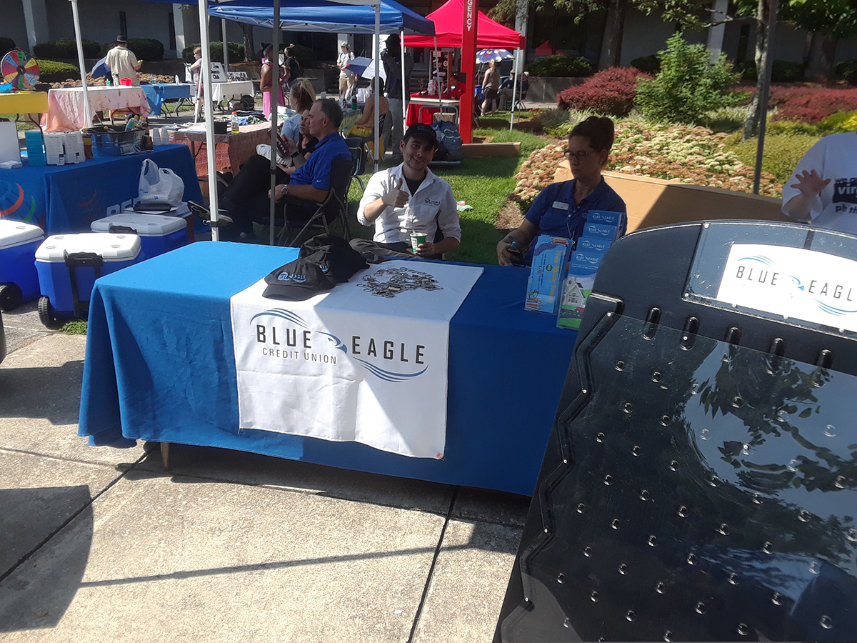 Blue Eagle Credit Union had a table at the VWCC Welcome Event! Various tables and activities can be seen in the background.