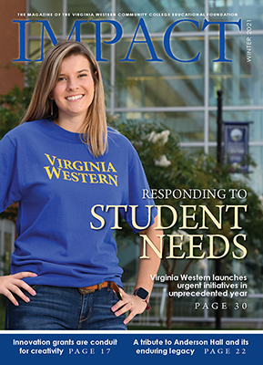Cover of Winter 2021 Impact Magazine - Shows female student in blue Virginia Western shirt standing in front of a building